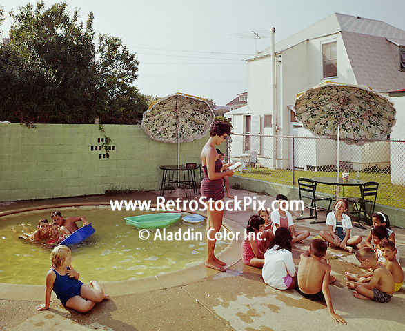 Lareine - Bradley Hotel, Woman reading to kids by the kiddie pool. 1961