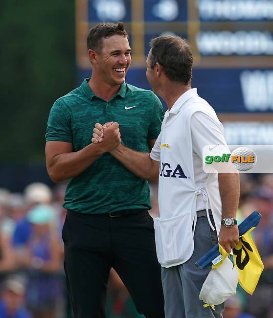 Brooks Koepka(USA) celebrates winning the 100th PGA Championship with his caddie Ricky Elliott at Bellerive Country Club, St. Louis, Missouri.<br /> Picture Tom Russo / Golffile.ie<br /> <br /> All photo usage must carry mandatory copyright credit (© Golffile   Tom Russo)