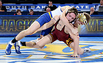 BROOKINGS, SD - NOVEMBER 17: Seth Gross from South Dakota State tries to roll Mitch Mckee from the University of Minnesota during their 133 pound match Friday evening at First Arena in Brookings, SD.  (Photo by Dave Eggen/Inertia)