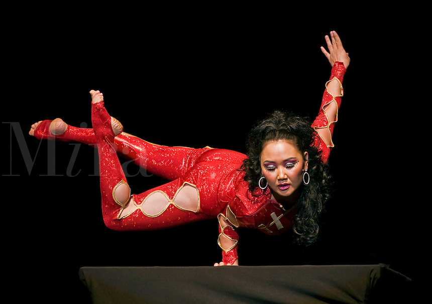 FEMALE CONTORTIONIST during MONGOLIAN NIGHT at a DALAI LAMA teaching in October 2007 sponsored by KUMBUM CHAMTSE LING & the TIBETAN CULTURAL CENTER - BLOOMINGTON, INDIANA