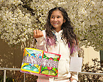 Kimberly Burgara, 11, of Carson City, displays a Easter egg basket she made of Peeps during the 7th Annual Easter Fiesta at Western Nevada College Saturday, March 26, 2016. The event, hosted by the Association of Latin American Students, had 3 separate egg hunts, face painting, limbo, musical chairs, ring toss, sack races, bowling,  food, music and a piñata.  <br />