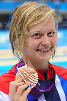 PICTURE BY ALEX BROADWAY /SWPIX.COM - 2012 London Paralympic Games - Day Seven - Swimming, Aquatic Centre, Olympic Park, London, England - 05/09/12 - Hannah Russell of Great Britain poses with her Bronze Medal after the Women's 100m Backstroke S12 Final.
