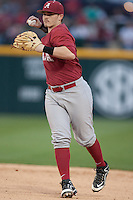 Alabama Crimson Tide infielder Mikey White (1) throws to first base at Baum Stadium during the NCAA baseball game against the Arkansas Razorbacks on March 21, 2014 in Fayetteville, Arkansas.  The Alabama Crimson Tide defeated the Arkansas Razorbacks 17-9.  (William Purnell/Four Seam Images)