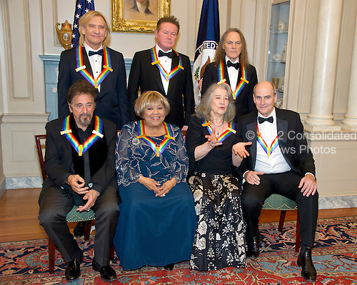 "The five recipients of the 39th Annual Kennedy Center Honors pose for a group photo following a dinner hosted by United States Secretary of State John F. Kerry in their honor at the U.S. Department of State in Washington, D.C. on Saturday, December 3, 2016.  From left to right back row: Joe Walsh, Don Henley, and Timothy B. Schmidt of the rock band ""The Eagles."" Front row, left to right: Al Pacino, Mavis Staples, Martha Argerich, and James Taylor.  The 2016 honorees are: Argentine pianist Martha Argerich; rock band the Eagles; screen and stage actor Al Pacino; gospel and blues singer Mavis Staples; and musician James Taylor.  From left to right back row: Joe Walsh, Don Henley, and Timothy B. Schmidt of the rock band ""The Eagles."" Front row, left to right: Al Pacino, Mavis Staples, Martha Argerich, and James Taylor.<br /> Credit: Ron Sachs / Pool via CNP"