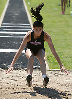 NWA Democrat-Gazette/ANDY SHUPE<br /> Megan Hastings of Fayetteville leaps Wednesday, May 15, 2019, while competing in the long jump portion of the state heptathlon championship at Ramay Junior High School. Visit nwadg.com/photos to see more photographs from the meet.