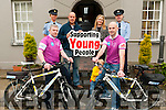 Garda Charity Cycle: Pictured at Listowel Garda Station to announce the participation of six Listowel gardai who will take part in the Ring of Beara Cycle on 23rd May in aid of Listowel KDYS. Front: Sgt. John Davis & Sgt. Tim O'Keeffe with Kevin. Back : Sgt. Sandra Kelly, Gareth Harteveld, KDYS, Caroline Duane, KDYS & Supertindent Dan Keane, Listowel Garda.