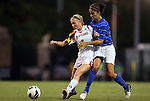 20 September 2012: Maryland's Ashley Spivey (left) and Duke's Gilda Doria (right). The University of Maryland Terrapins played the Duke University Blue Devils to a 2-2 tie after overtime at Koskinen Stadium in Durham, North Carolina in a 2012 NCAA Division I Women's Soccer game.