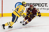Jon Merrill (Michigan - 24), Justin Fontaine (Duluth - 37) - The University of Minnesota-Duluth Bulldogs defeated the University of Michigan Wolverines 3-2 (OT) to win the 2011 D1 National Championship on Saturday, April 9, 2011, at the Xcel Energy Center in St. Paul, Minnesota.