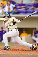 Jack Carey #20 of the Wake Forest Demon Deacons follows through on his swing against the LSU Tigers at Alex Box Stadium on February 20, 2011 in Baton Rouge, Louisiana.  The Tigers defeated the Demon Deacons 9-1.  Photo by Brian Westerholt / Four Seam Images