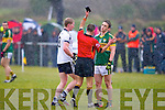 Kerry's Stephen O'Brein receiving the first black card in the county by ref James Bermingham at John Mitchels on Sunday.