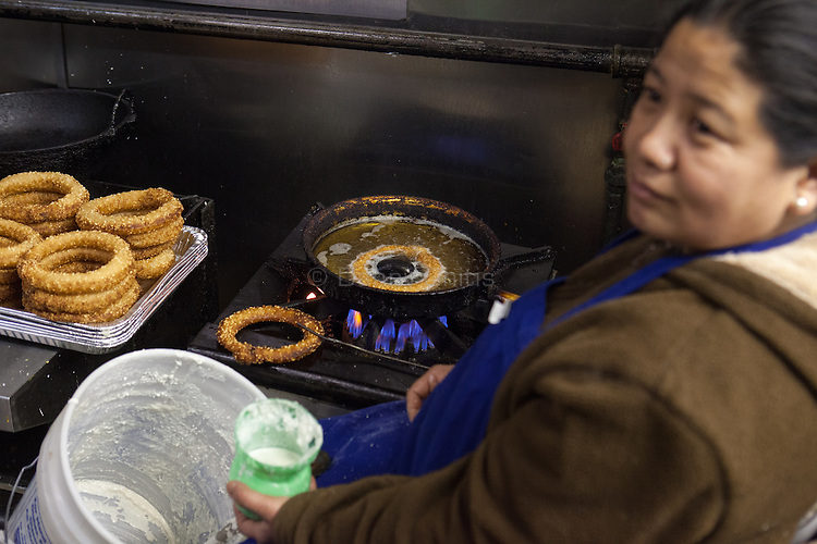 Gyanu Thapa prepares roti at Dhaulagiri Kitchen, a tiny Nepalese restaurant in Jackson Heights. <br /> <br /> Danny Ghitis for The New York Times