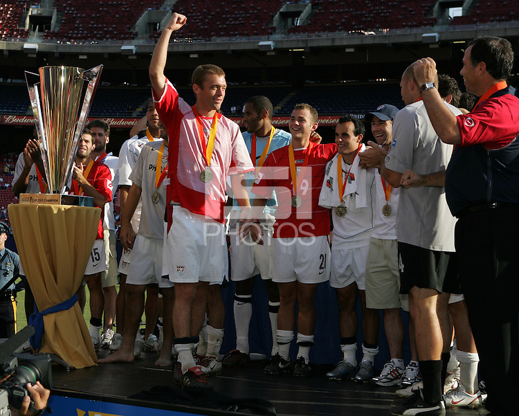 July 24, 2005: East Rutherford, NJ, USA: USMNT defender Jimmy Conrad (12) celebrates with his team during the trophy presentation for the CONCACAF Gold Cup at Giants Stadium.  The USMNT won 3-1 on penalty kicks.