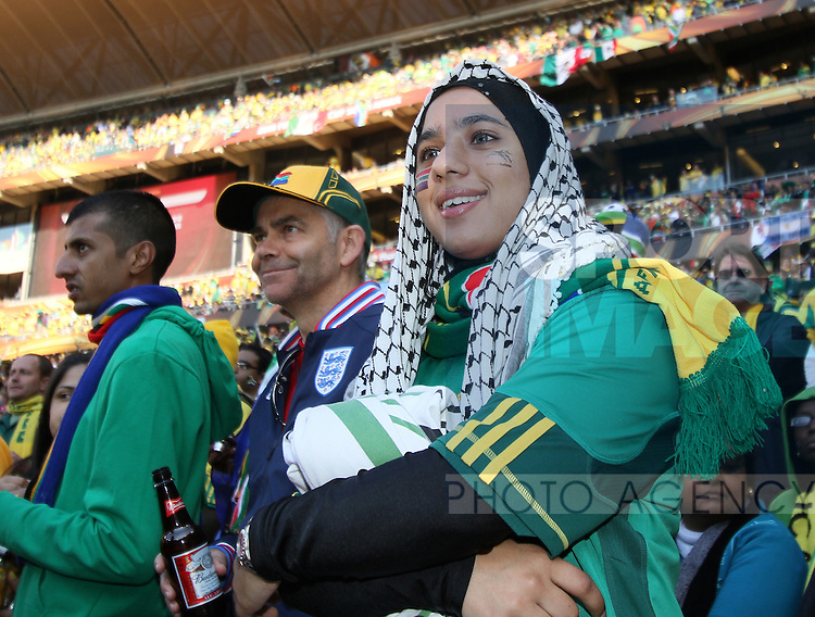 A South African fan watches on