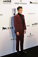 HONG KONG - MARCH 14:  Singer T.O.P. arrives on the red carpet during the 2015 amfAR Hong Kong gala at Shaw Studios on March 14, 2015 in Hong Kong. Photo : Lucas Schifres/Abaca  (Photo by Lucas Schifres/Lucas Schifres)