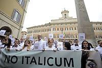 Roma, 27 Aprile 2015<br /> Manifestazione con flash mob di Ialia Unica contro la legge elettorale in discussione alla Camera dei Deputati.<br /> No Italicum, legge cerotto.<br /> Manifestanti indossano un bavaglio.<br /> Al centro Corrado Passera