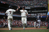 SAN FRANCISCO, CA - MAY 25:  Trevor Brown #14 of the San Francisco Giants celebrates with teammate Gregor Blanco #7 after scoring a run against the San Diego Padres during the game at AT&T Park on Wednesday, May 25, 2016 in San Francisco, California. Photo by Brad Mangin
