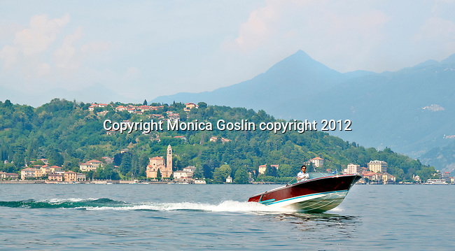 A speed boat passes the town of Tremezzo on Lake Como, Italy