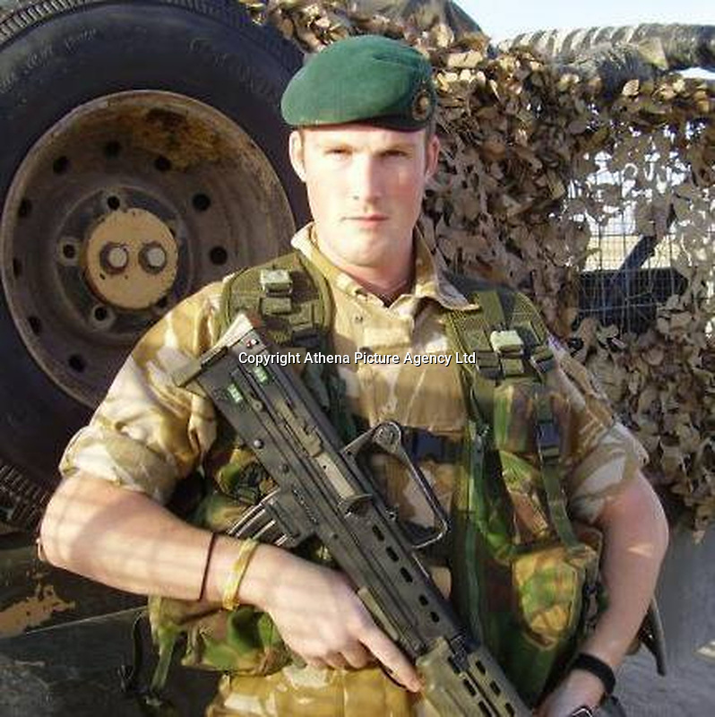 Pictured: Barry Rogers in the army<br /> Re: A mother and son will go on trial at Swansea crown court charged with murdering 84 year old Betty Guy.<br /> Mrs Guy died on November 7, 2011, and her body was cremated soon afterwards.<br /> Her daughter, Penelope John, aged 50, and her grandson, Barry Rogers, 32, have previously denied her murder and an alternative charge of manslaughter.<br /> The court has previously heard that the prosecution case involved 75 hours of recorded statements made by the defendants.