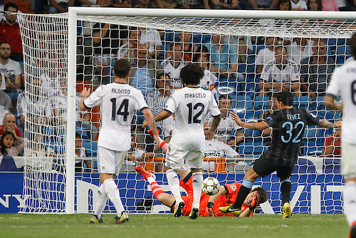18.09.2012. Madrid. Spain.  Champions League   match played between Real Madrid CF vs  Manchester City at Santiago Bernabeu stadium. The picture show Carlos Tevez (Striker of Manchester City) and  Iker Casillas (spanish goalkeeper of Real Madrid) Real Madrid rallied to win the game 3-2.