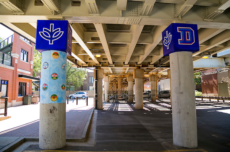 """DePaul University, Public Art Chicago App - CTA Fullerton Murals, Brother Mark Elder -  A series of muralsMonday, Aug. 8, 2016, on the massive concretepillars supporting the CTA's """"L"""" station and tracks at Fullerton. Throughout the spring 2016 quarter and into the summer, Brother Mark Elder, C.M., and his Mural Class students created several portraits and historically-themed murals that will eventually wrap the support columns, which runs right through DePaul's Lincoln Park Campus. The murals depict many prominent, historical figures that have made an impact on DePaul University. (DePaul University/Joel Dik)"""