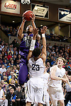 SIOUX FALLS, SD - FEBRUARY 27:  Daniel Hurtt #15 from the University of Sioux Falls draws a blocking foul on Jordan Spencer #23 from Augustana during their NSIC Tournament game Saturday night at the Pentagon in Sioux Falls. (Photo by Dave Eggen/Inertia)