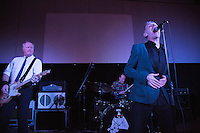17 DEC 2014 - STOWMARKET, GBR - Dr Feelgood's Steve Walwyn (left) on lead guitar, Kevin Morris (centre) on drums and vocalist Robert Kane (right) perform at the John Peel Centre for Creative Arts in Stowmarket, Suffolk, Great Britain (PHOTO COPYRIGHT © 2014 NIGEL FARROW, ALL RIGHTS RESERVED)