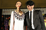 Taiwan born fashion designer, Malan Breton walks runway with model for the close of his Spring 2015 collection fashion show, for the Celebrate Taiwan event in Grand Central Terminal on September 27, 2014.