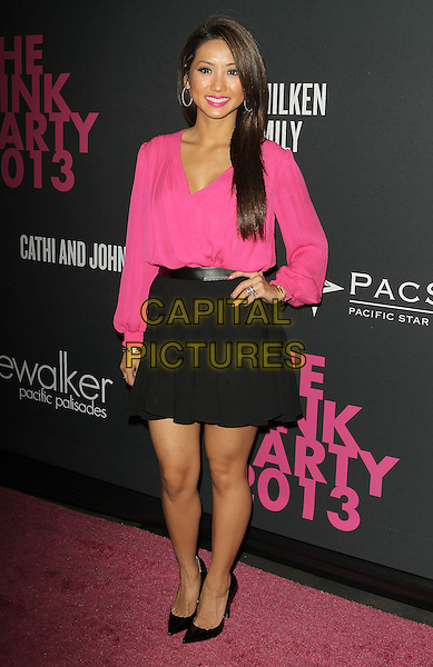 Brenda Song<br /> The Pink Party 2013 held at the Santa Monica Airport, Santa Monica, California, USA.<br /> October 19th, 2013<br /> full length blouse black skirt hand on hip<br /> CAP/ADM/KB<br /> &copy;Kevan Brooks/AdMedia/Capital Pictures