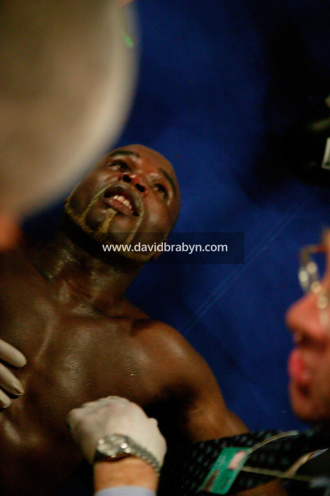 7 January 2006 - New York City, NY - A dazed Frenchman Jean-Marc Mormeck (C) lies on the ring floor after being knocked out in the 10th round by O'Neill Bell during the World Cruiserweight Championship unification fight at Madison Square Garden in New York City, USA, 7 January 2006.