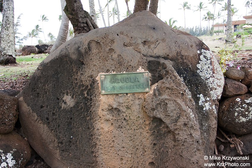 """Hauola City of Refuge"" sign on large boulder at the Hikina'akala Heiau, Kauai"