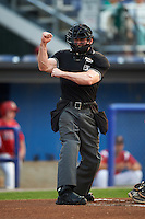 Umpire Matt Scott during a game between the West Virginia Black Bears and Batavia Muckdogs on August 31, 2015 at Dwyer Stadium in Batavia, New York.  Batavia defeated West Virginia 5-4.  (Mike Janes/Four Seam Images)
