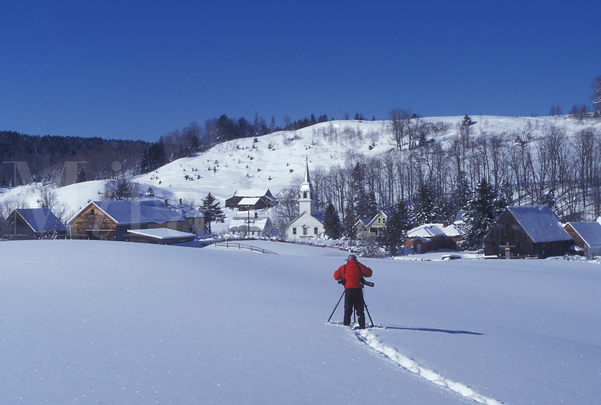 Vermont, VT, Photographer takes picture of the scenic village of East Corinth in a snow-covered field in the winter.