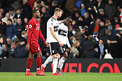 17th March 2019, Craven Cottage, London, England; EPL Premier League football, Fulham versus Liverpool; Calum Chambers of Fulham consoles Jean Michael Seri at half time