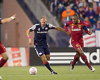 New England Revolution forward Ilija Stolica (9) brings the ball out as Real Salt Lake defender Jamison Olave (4) defends. Real Salt Lake defeated the New England Revolution, 2-1, at Gillette Stadium on October 2, 2010.