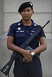 In a country surrounded by violence and terrorism, an armed soldier stands watch outside a sacred temple in the Grand Palace complex in Bangkok, Thailand. (Jim Bryant Photo).....
