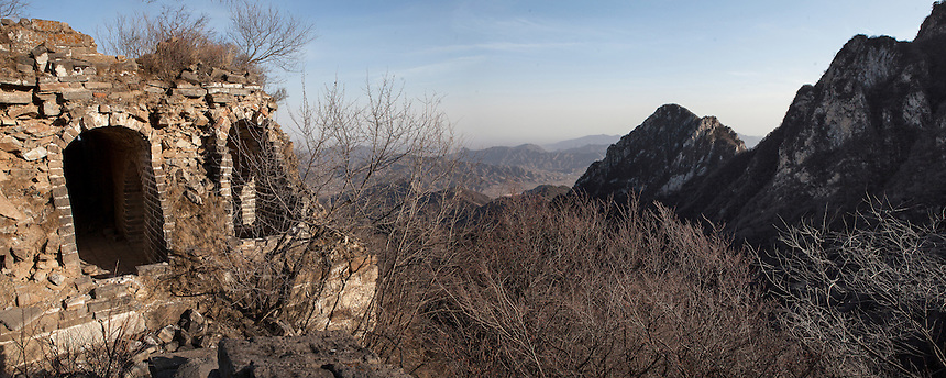 A crumbling tower at Jiankou Great Wall. Located in the extremely rugged terrain, this part of the Great Wall regarded as one of the most dangerous. This panoramic photograph is made from 3 images.