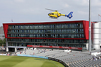 The air ambulance lands at the ground to attend a medical emergency during Lancashire CCC vs Essex CCC, Specsavers County Championship Division 1 Cricket at Emirates Old Trafford on 11th June 2018