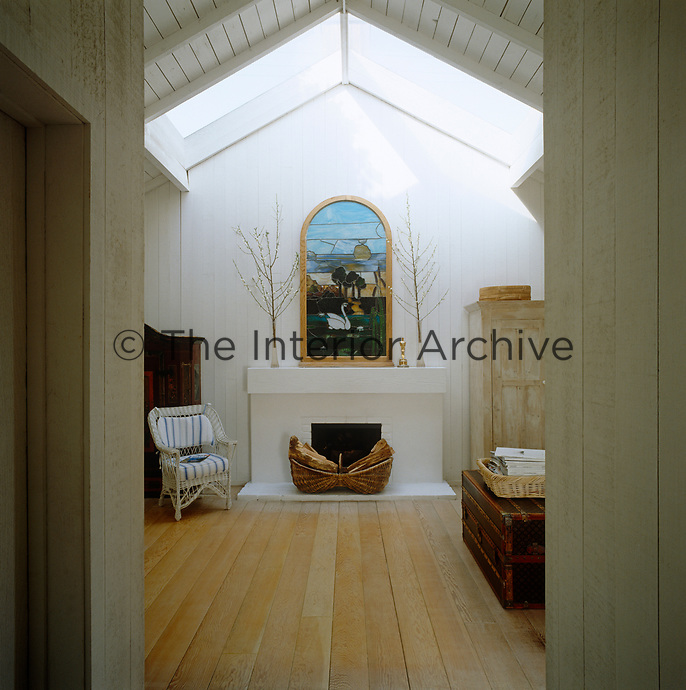 A picture made of stained glass lends a chapel-like feel to this bedroom