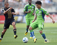 Fred #7 of the Philadelphia Union moves in on Fredy Montero #17 of the Seattle Sounders FC during the first MLS match at PPL stadium in Chester, PA. on June 27 2010. Union won 3-1.