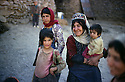 Iran1983 .In Garmave, village of Alan, district of Sarrdasht, a family with the grand-mother and her grand-children.Iran 1983.Garmave, village de Alan, region de Sardasht, une famille devant la maison avec la grand-mere et ses petits-enfants