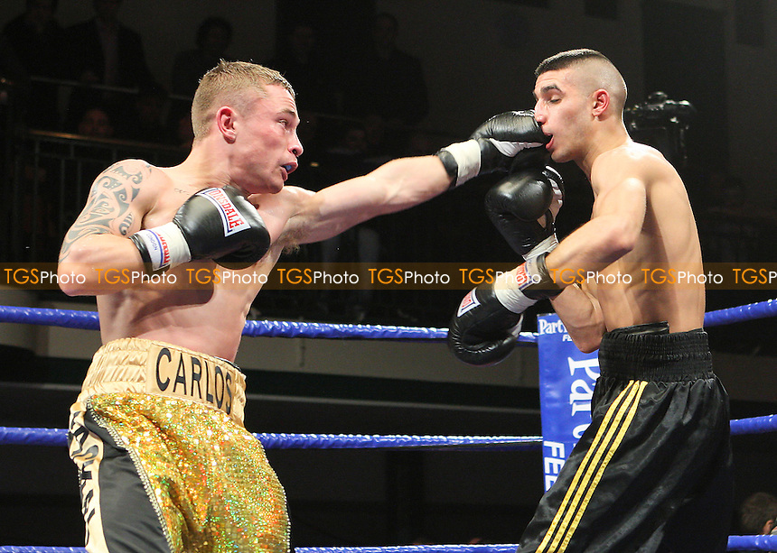 Carl Frampton (gold shorts) defeats Yoan Boyeaux in a Super-Bantamweight boxing contest at York Hall, Bethnal Green, promoted by Barry Hearn / Matchroom Sports - 12/02/10 - MANDATORY CREDIT: Gavin Ellis/TGSPHOTO - Self billing applies where appropriate - Tel: 0845 094 6026