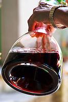 Marlène Soria Domaine Peyre Rose, St Pargoire. Gres de Montpellier. Languedoc. Pouring wine in a decanter. France. Europe.