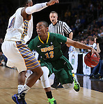 SIOUX FALLS, SD - MARCH 10: Lawrence Alexander #12 of North Dakota State drives on Deondre Parks #0 of South Dakota State in the first half of the men's Summit League Championship Tournament game Tuesday at the Denny Sanford Premier Center in Sioux Falls, SD. (Photo by Dick Carlson/Inertia)