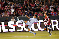 Sporting Kansas City defender Roger Espinoza (15) reaches for the ball. Sporting KC defeated CD Chivas USA 3-2 at Home Depot Center stadium in Carson, California on Saturday March 19, 2011...