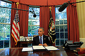 United States President Barack Obama looks over H.R. 1314, the Bipartisan Budget Act of 2015 before his signs it into law in the Oval Office of the White House in Washington, DC on November 2, 2015<br /> Credit: Dennis Brack / Pool via CNP