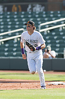 Salt River Rafters first baseman Tyler Nevin (2), of the Colorado Rockies organization, jogs off the field between innings of an Arizona Fall League game against the Surprise Saguaros at Salt River Fields at Talking Stick on October 23, 2018 in Scottsdale, Arizona. Salt River defeated Surprise 7-5 . (Zachary Lucy/Four Seam Images)