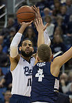 Nevada forward forward Cody Martin (11) takes a jump shot over Utah State guard Crew Ainge (4) in the first half of an NCAA college basketball game in Reno, Nev., Wednesday, Jan. 2, 2019. (AP Photo/Tom R. Smedes)
