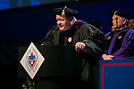 Jason Martin, associate professor, serves as one of the university marshals Sunday, June 11, 2017, during the DePaul University College of Computing and Digital Media and the College of Communication commencement ceremony at the Allstate Arena in Rosemont, IL. (DePaul University/Jamie Moncrief)