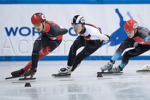 1st February 2019, Dresden, Saxony, Germany; World Short Track Speed Skating; 1000 meters men in the EnergieVerbund Arena. Florian Becker (M) from Germany runs alongside Samuel Girard (l) from Canada and Emir Muhammed Han (r) from Turkey in a bend.