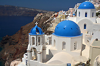 Michael McCollum.6/20/11.Santorini's iconic blue dome rooftops , city of Oia,in the morning sun.
